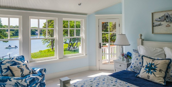 Pretty blue bedroom overlooking the water on Cape Cod   hookedonhouses.net