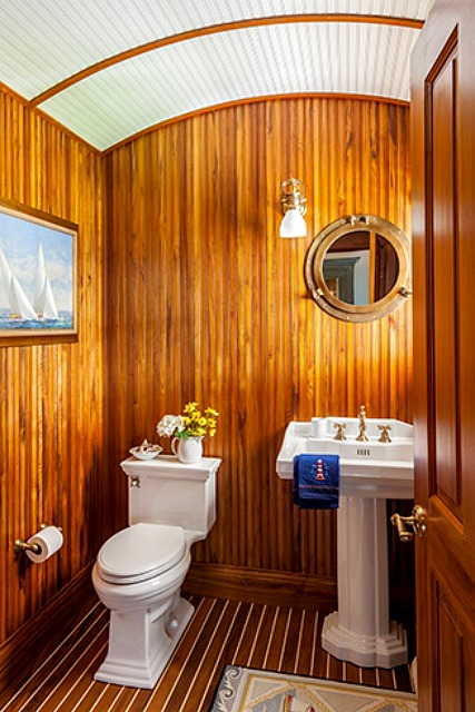 Bathroom with barreled ceiling and wood-paneled walls in Cape Cod | hookedonhouses.net