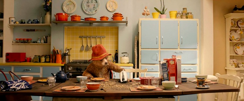 Paddington eats at kitchen table