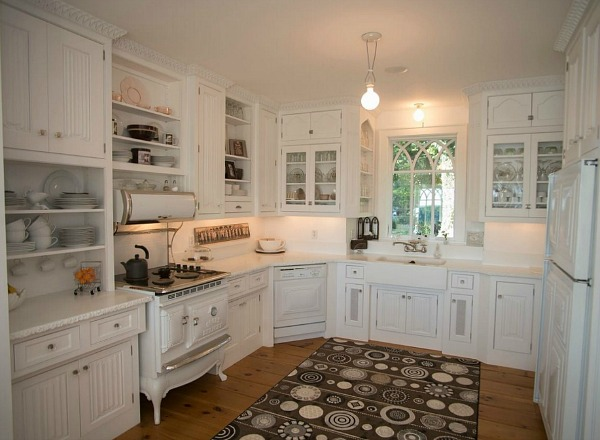 kitchen with vintage range and white cabinets