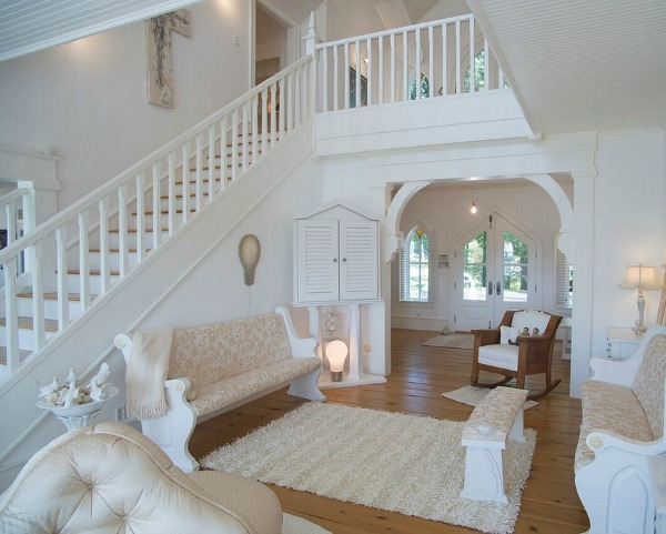 staircase painted white inside front entry hall