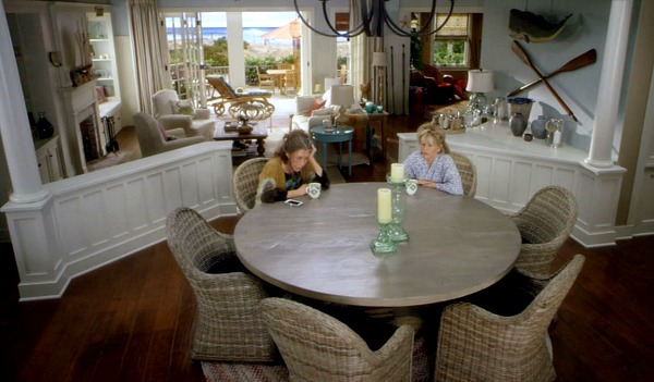 Grace and Frankie\'s dining room with round table and rattan chairs