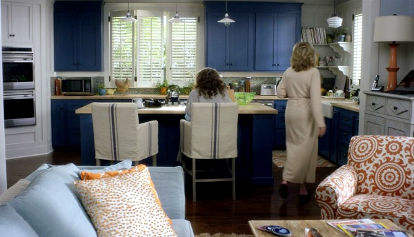 Lily Tomlin and Jane Fonda in the beach house kitchen with blue cabinets