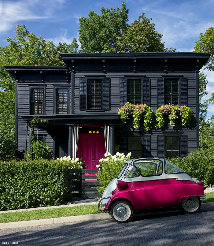 Roger and Chris's black house with pink door and pink car