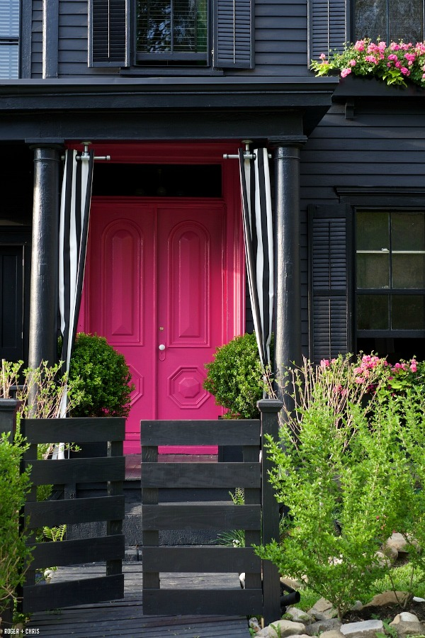 Black house with hot-pink front door