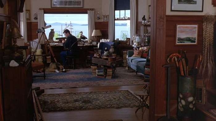 Mel Gibson\'s character sitting at his desk in front of the window