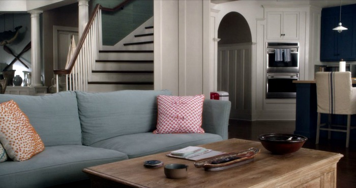 "Beach house family room with blue sofa on ""Grace and Frankie"""