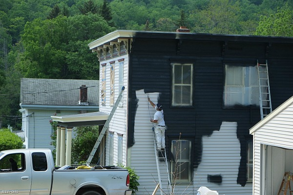Painting the white Victorian house black