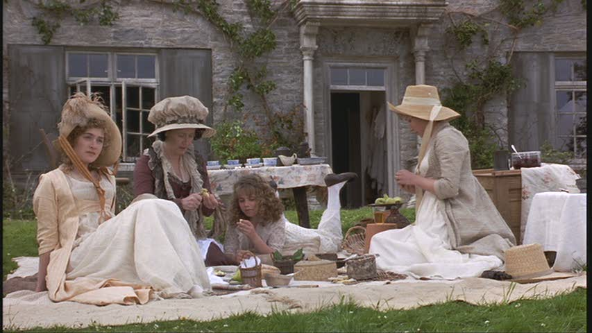 a picnic in front of the cottage