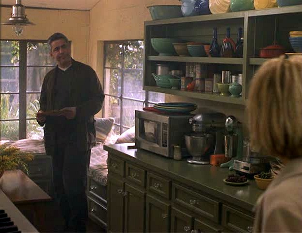 Meg Ryan\'s colorful kitchen with open shelves in Hanging Up movie