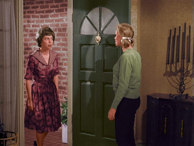 Samantha at the front door of her house on Bewitched TV sitcom