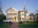 front exterior of an Italianate house in Cape Cod with yellow door