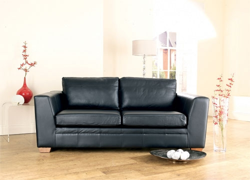 giving old leather sofas a new look with slipcovers. Black Bedroom Furniture Sets. Home Design Ideas
