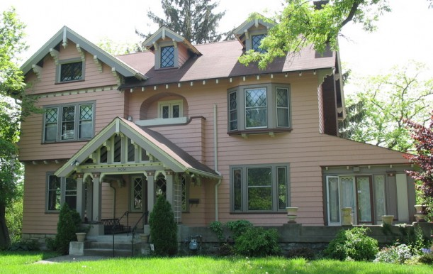 large pink house with leaded glass windows