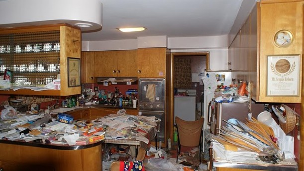 A cluttered kitchen before staging
