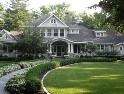 large gray house with curving walkway