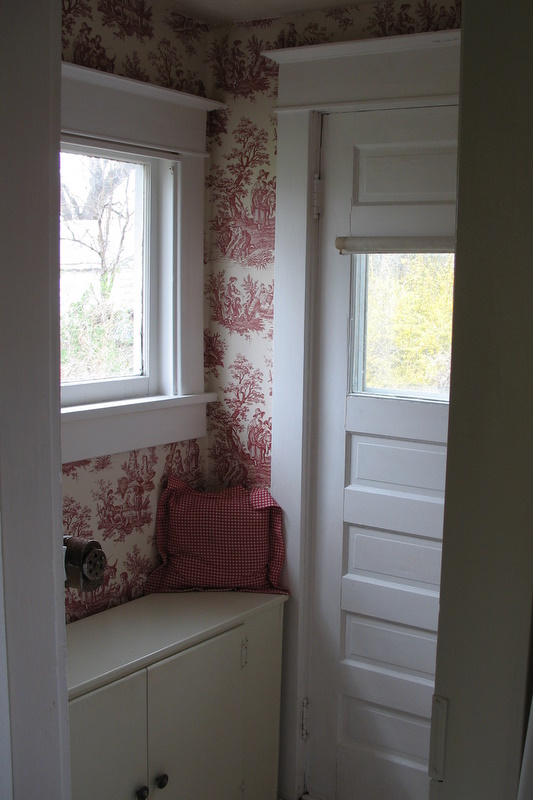 mudroom with red and white toile wallpaper