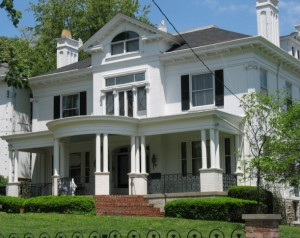 large white house with front porch and black shutters