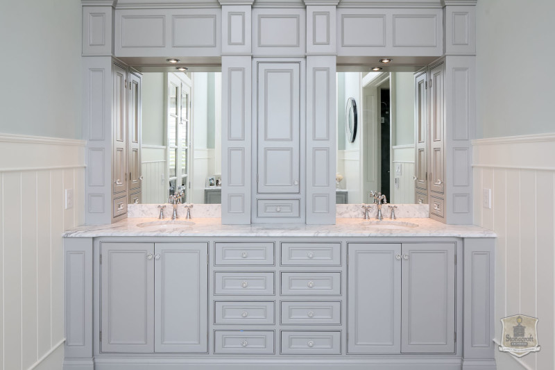 owner\'s bathroom with built in storage between two sinks