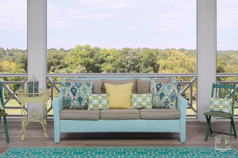 blue outdoor sofa on back porch