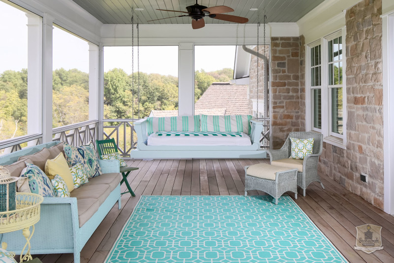 back porch with seating and swing