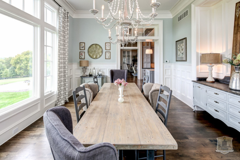 dining room table and mismatched chairs