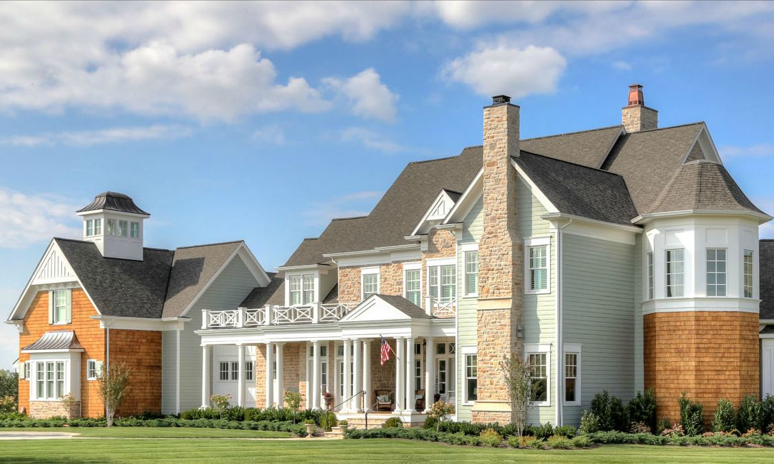 Greystone Country House with front porch in Kentucky built by Stonecroft Homes