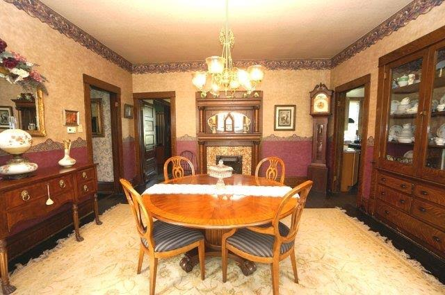 dining room with original antique fireplace