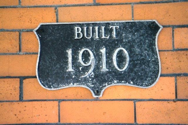 sign on front porch that says built in 1910