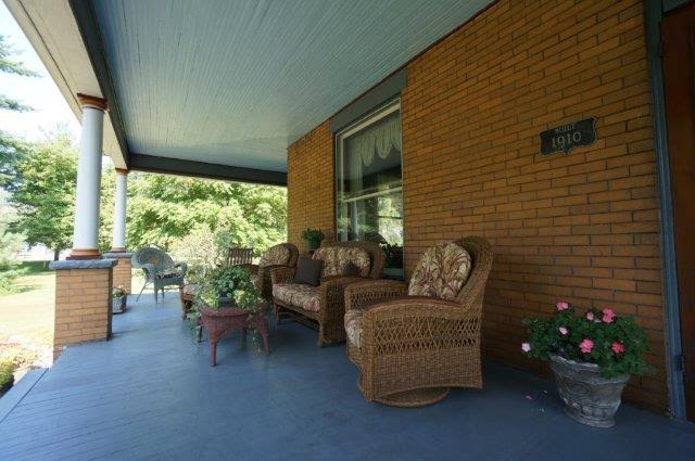 front porch of house with wicker seating