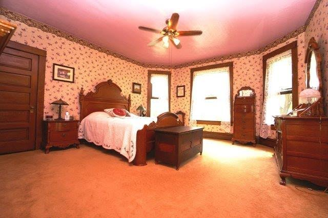 antique bed in upstairs bedroom