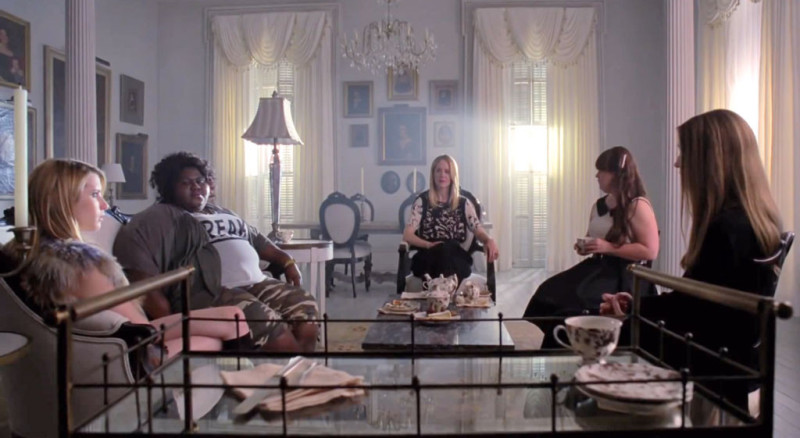 witches gathered in Miss Robichaux's Academy living room AHS Coven