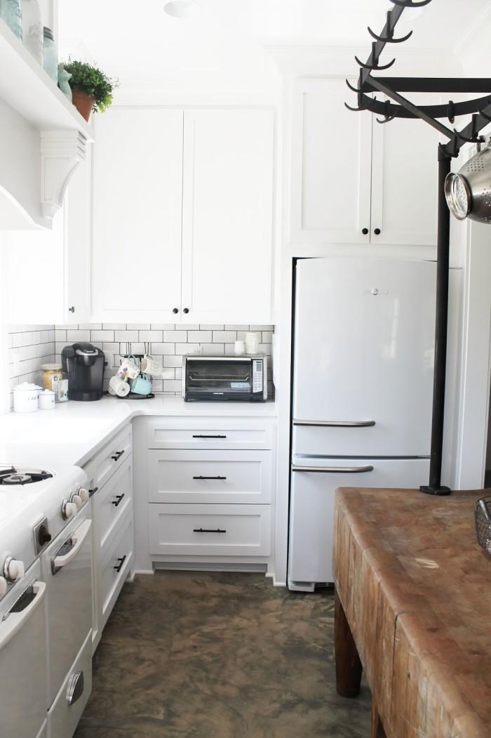 Vintage looking white Smeg refrigerator in kitchen