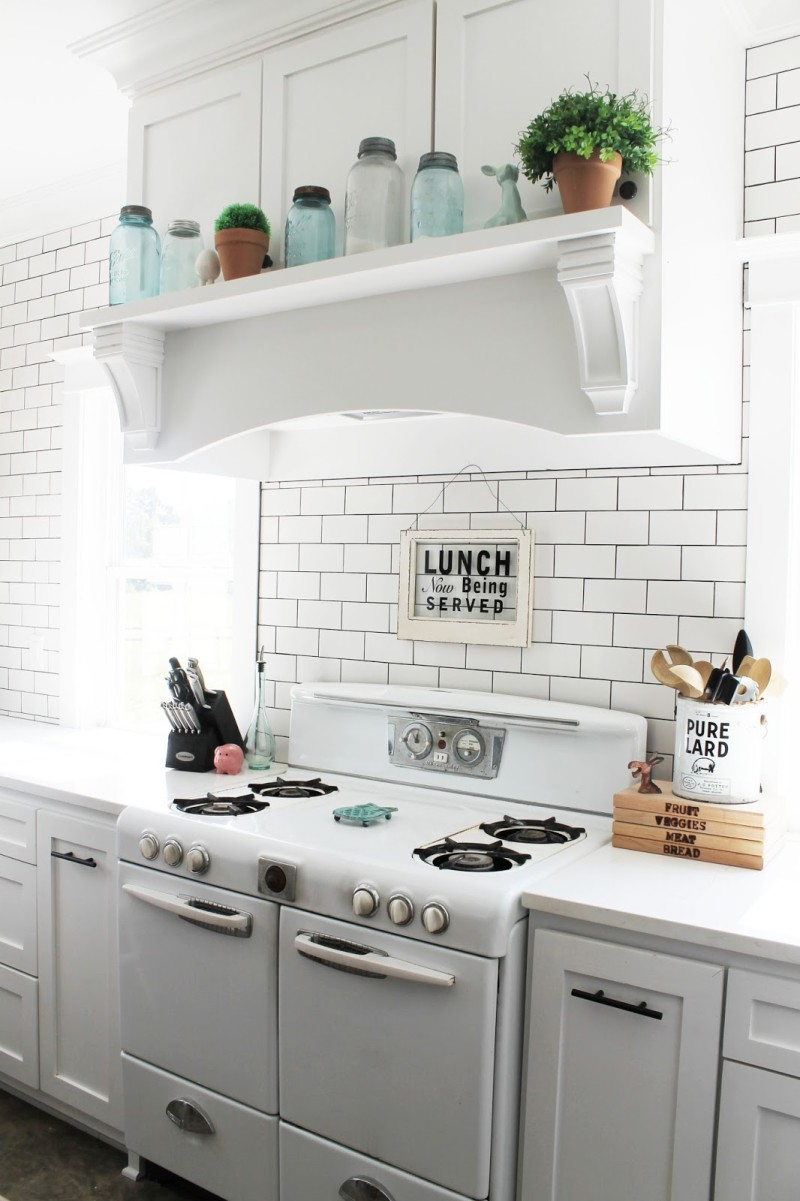 Vintage kitchen stove with sign that says Lunch is being served