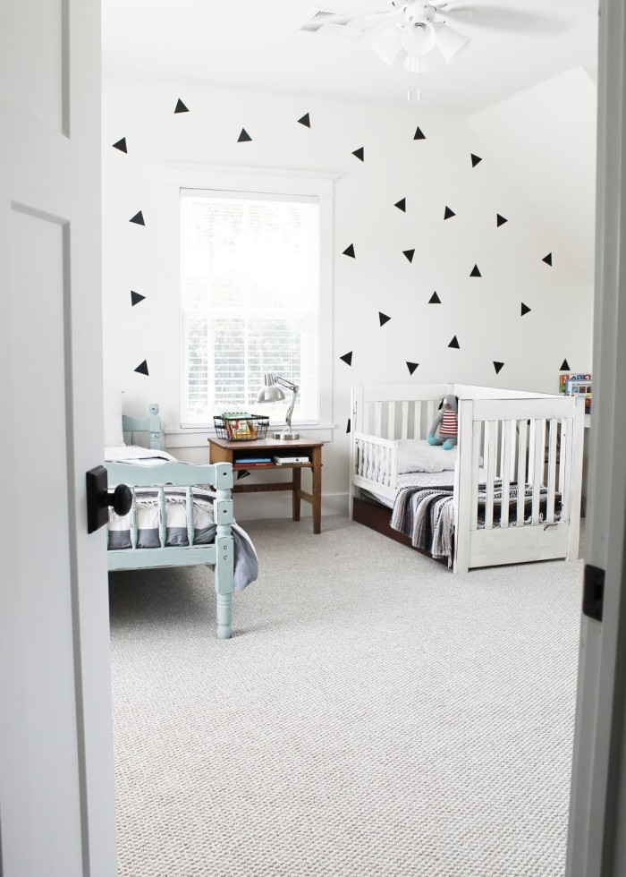 Boys\' bedroom with geometric wallpaper on feature wall