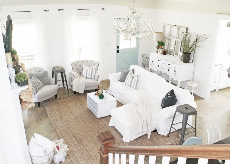 Overhead view of farmhouse living room with white slipcovered sofa