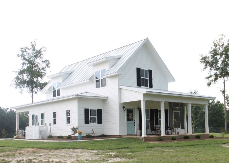 Brittany York\'s Sugarberry Cottage Farmhouse with black shutters and front porch