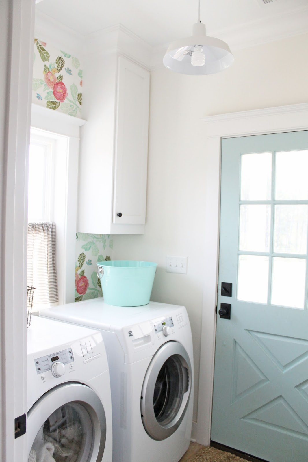 Laundry room with floral wallpaper