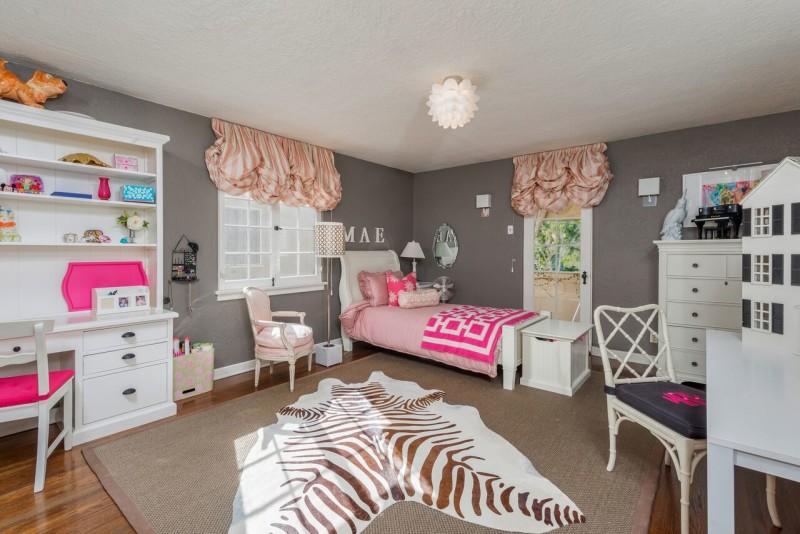 girl\'s bedroom with faux zebra print rug on floor