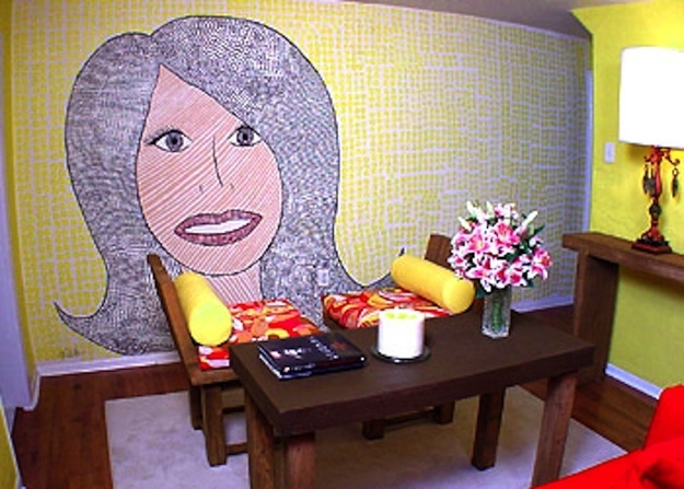 Hildi paints a mural of herself on a wall Trading Spaces
