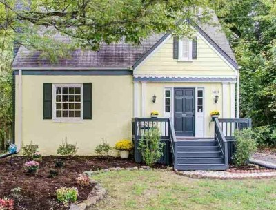 Yellow bungalow featured on LIOLI For Sale in Raleigh NC
