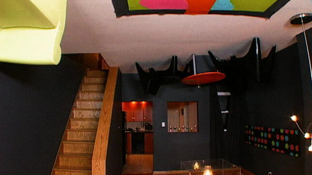 black basement with furniture on ceiling