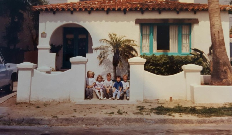old photo with kids in front of house