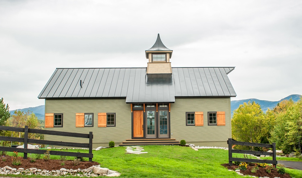 A new house built to look like an old barn for New home plans that look old