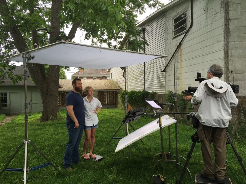 Erin and Ben Napier filming scene in the yard