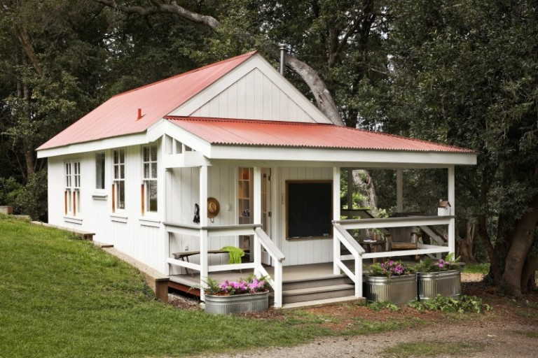 A little summer cottage with red roof and front porch