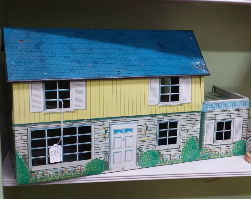 blue and yellow tin dollhouse