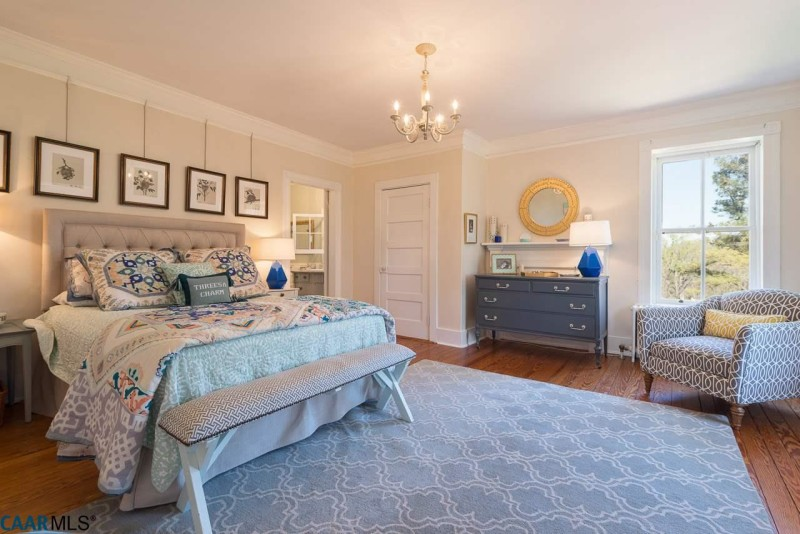 Owner\'s bedroom with bed and dresser