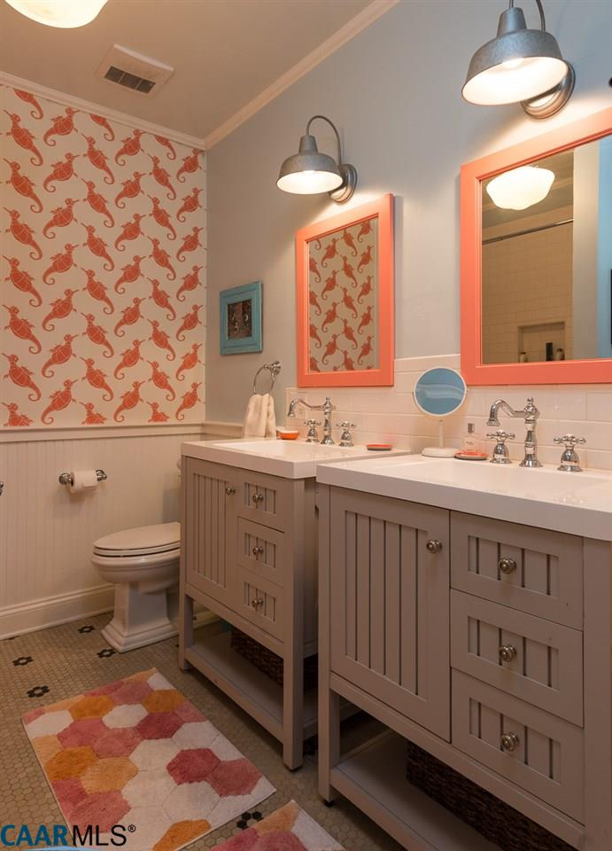 Bathroom with two vanities and sinks
