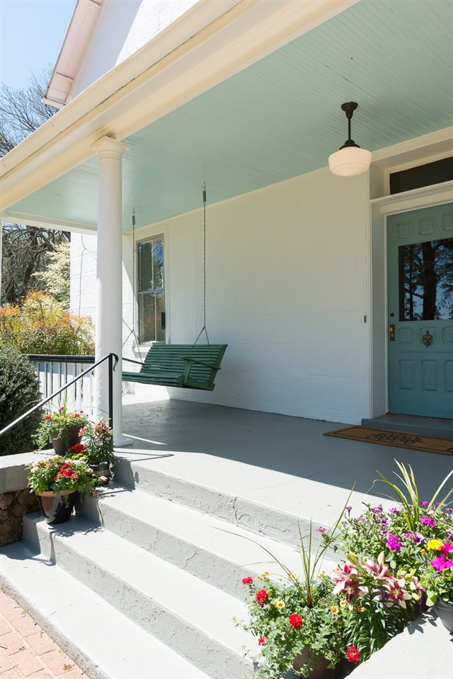 Front porch with swing and pale blue painted ceiling